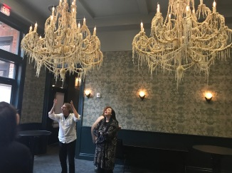 The chandeliers in the room where we'll host our opening reception.
